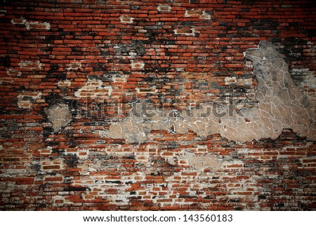 Crack weathered brick wall fragment - stock photo