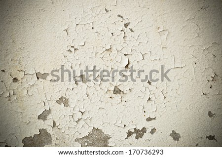 Cracked and peeling paint and grunge old wall with texture - stock photo