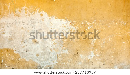 Cracked and peeling paint and grunge old wall with texture. - stock photo