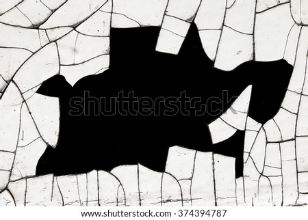 cracked and peeling white painted old wall with black  space for text - stock photo