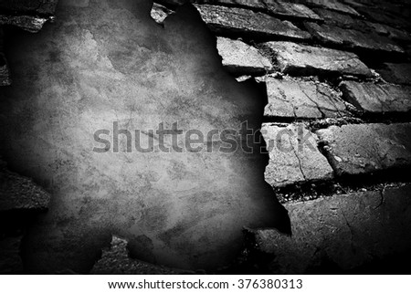 cracked brick wall with large hole background - stock photo