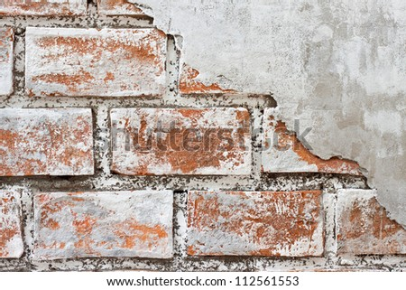 cracked concrete old weathered brick wall fragment - stock photo