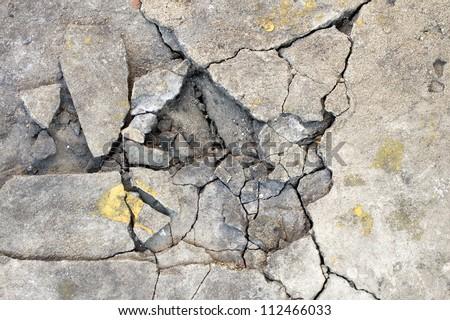Cracked concrete texture closeup background. - stock photo