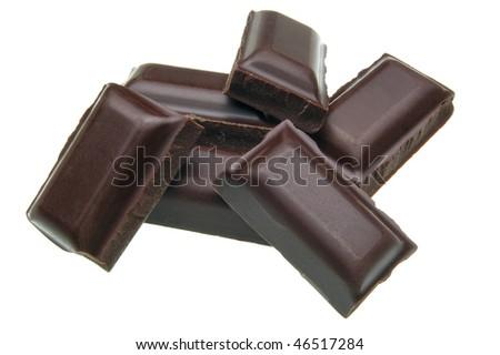 Cracked dark chocolate pile on white background - stock photo