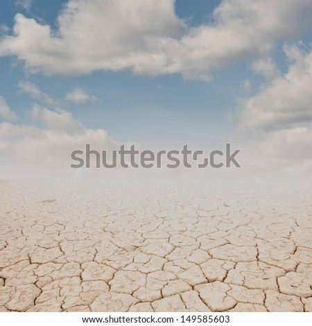 cracked desert terrain with sky on sunset - stock photo