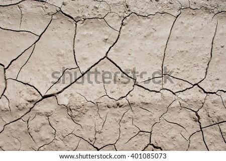 Cracked dry desert ground - stock photo