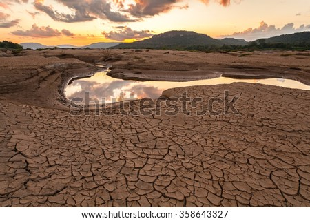 cracked earth near drying water on twilight at at Sam Pan Bok in Mekong river. Ubonratchathani Province ,Thailand - stock photo