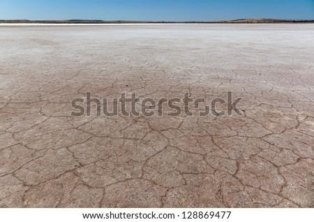 Cracked earth on dry bottom of salt lake. Lochiel. South Australia. - stock photo
