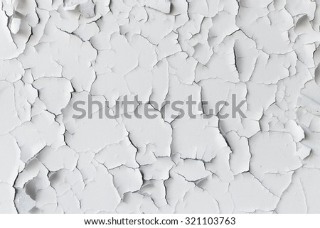 Cracked flaking white paint on the wall, background texture - stock photo