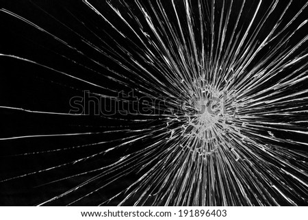Cracked glass against a black background - stock photo