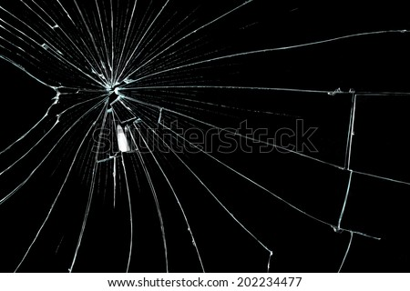 cracked glass on black background - stock photo