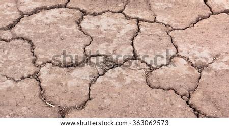 Cracked ground,Dry land. Cracked ground background,Dry cracked ground filling the frame as background, Drought land - stock photo