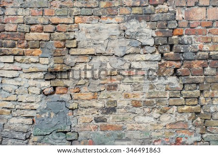 Cracked, heavily damaged brick wall texture background.  - stock photo