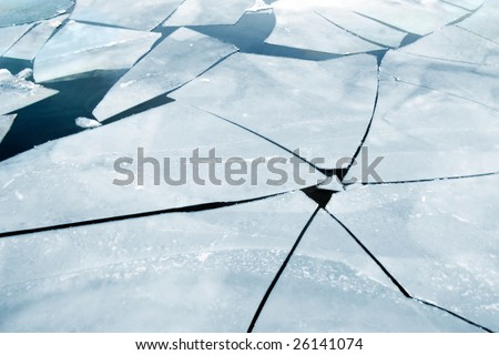 cracked ice on river in spring - stock photo