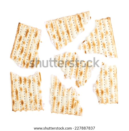 Cracked in multiple pieces machine made matza flatbread, composition isolated over the white background - stock photo