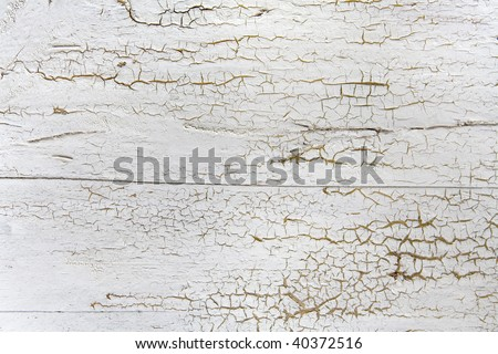 Cracked painted wooden board - stock photo
