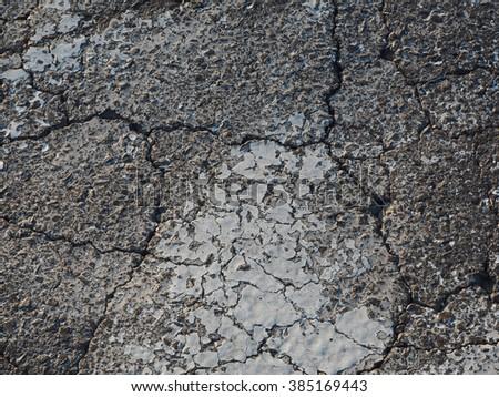Cracked pavement  - stock photo
