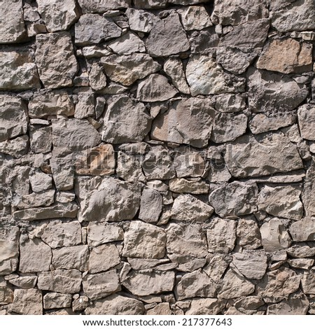 cracked real stone wall , for background or texture - stock photo