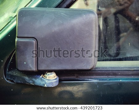 Cracked rear view mirror on a Old car - stock photo