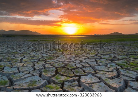 cracked soil and sunset - stock photo