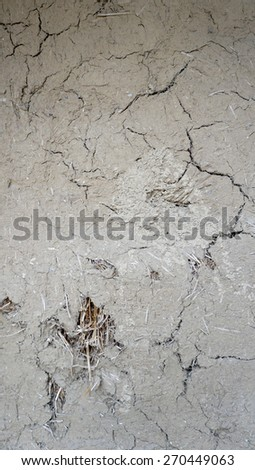 cracked texture on rough clay wall - stock photo