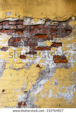 Cracked weathered dirty brick wall - stock photo