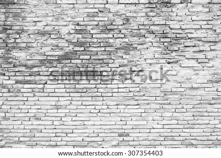 Cracked white grunge brick wall background - stock photo