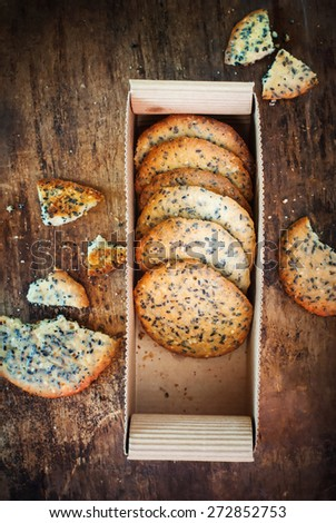 Cracker Cookies with Black Sesame Seeds in Box - stock photo