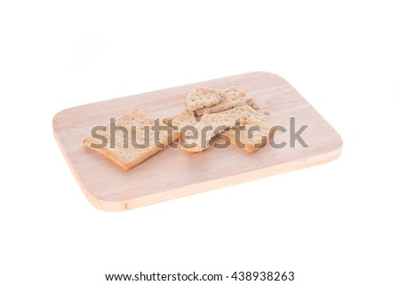 crackers and  on chopping board isolated white background - stock photo