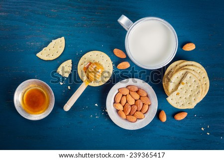 crackers, honey and nuts, the top view - stock photo