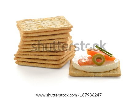 Crackers with cheese and tomato isolated on white background - stock photo