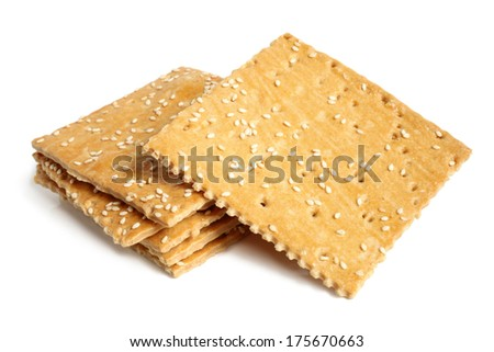 Crackers with sesame on white background   - stock photo