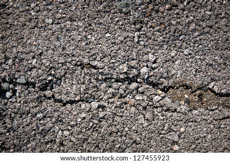 cracking on rough asphalted surface background ,cracking on  old asphalted road. - stock photo