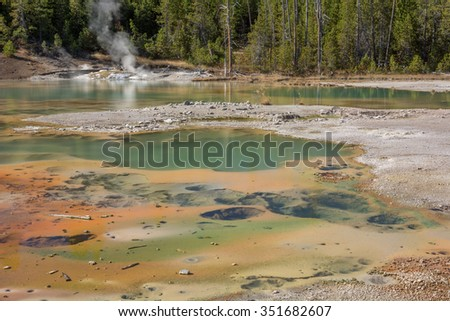 Crackling Lake in Norris Geyser Basin Yellowstone National Park, Wyoming. - stock photo