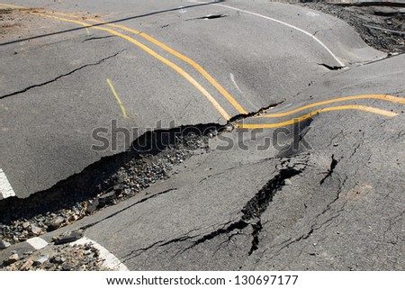 Cracks in the road, roadway violation - stock photo