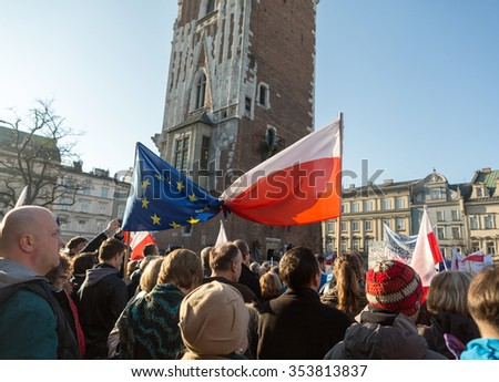 CRACOW, POLAND - DECEMBER 19, 2015: Cracow, Main Square - The demonstration of the Committee of the Protection of Democracy / KOD/ against the break of law through the government PIS in Poland.  - stock photo