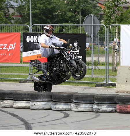 CRACOW, POLAND - MAY 21, 2016:  A stunt rider on a sport bike at 3rd edition of MOTO SHOW in Cracow. Poland.  - stock photo