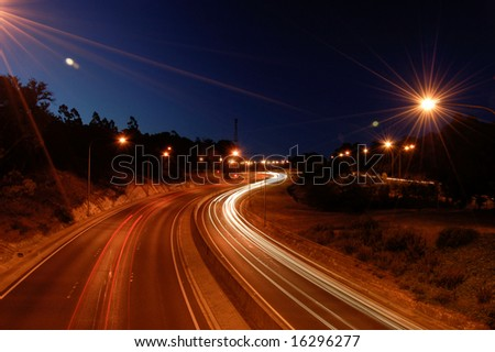 Crafers freeway at night with traffic blur showing motion of cars - stock photo