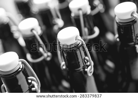 Craft beer bottles. Alcohol, brewing, beer and drinking concept. Black and white - stock photo