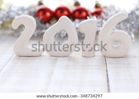 craft ceramic of 2016 with christmas decorations background on white wooden background. - stock photo