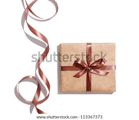 Craft gift box with curved brown ribbon isolated on white background. - stock photo