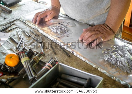 Craft man working , silver smith working  - stock photo