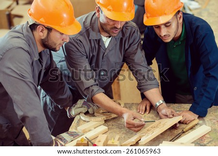 Craft workers in wood factory - stock photo