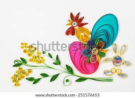 crafts with their hands of quilling on a holiday theme Happy Easter. Focus on eggs - stock photo