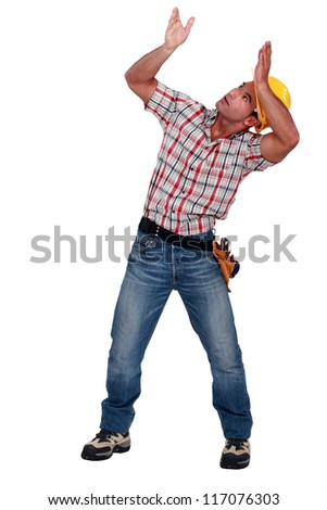craftsman carrying something - stock photo