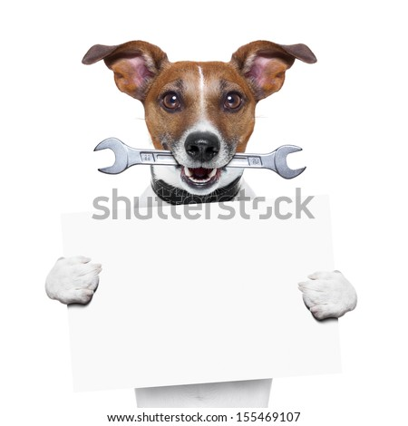craftsman dog with spanner wrench in mouth holding a blank banner - stock photo