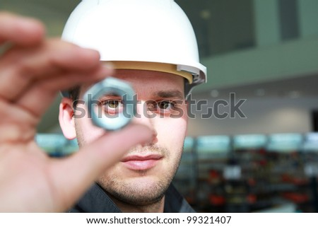 Craftsman holding a screw - stock photo