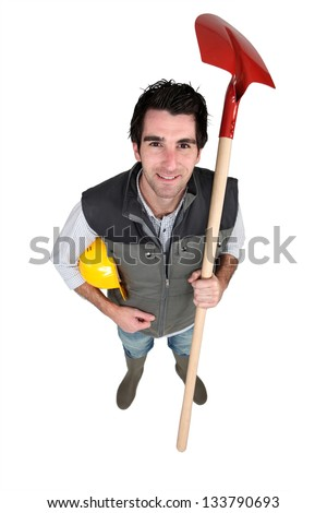 craftsman holding a shovel - stock photo