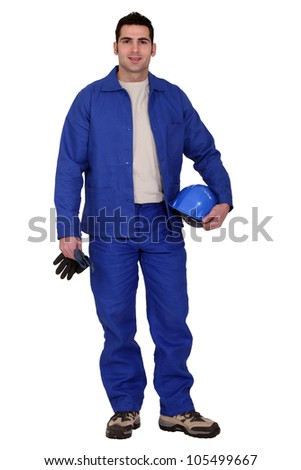craftsman holding his gloves and a helmet - stock photo