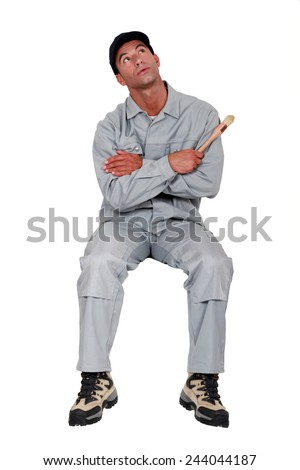 craftsman painter looking up - stock photo